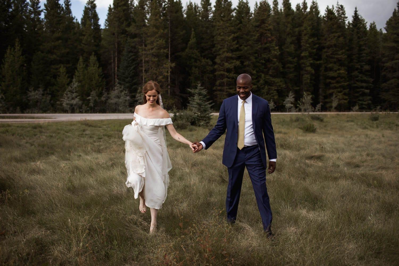 Bride and Groom walking photo