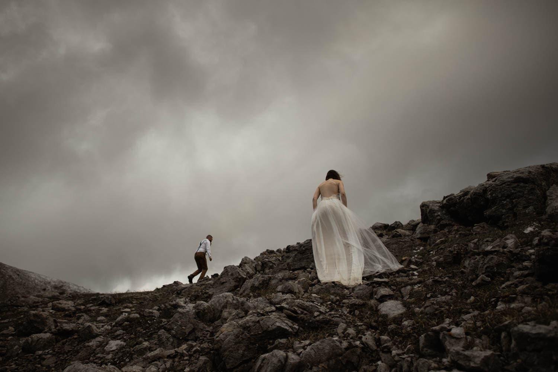Bride and Groom Climbing Mountain