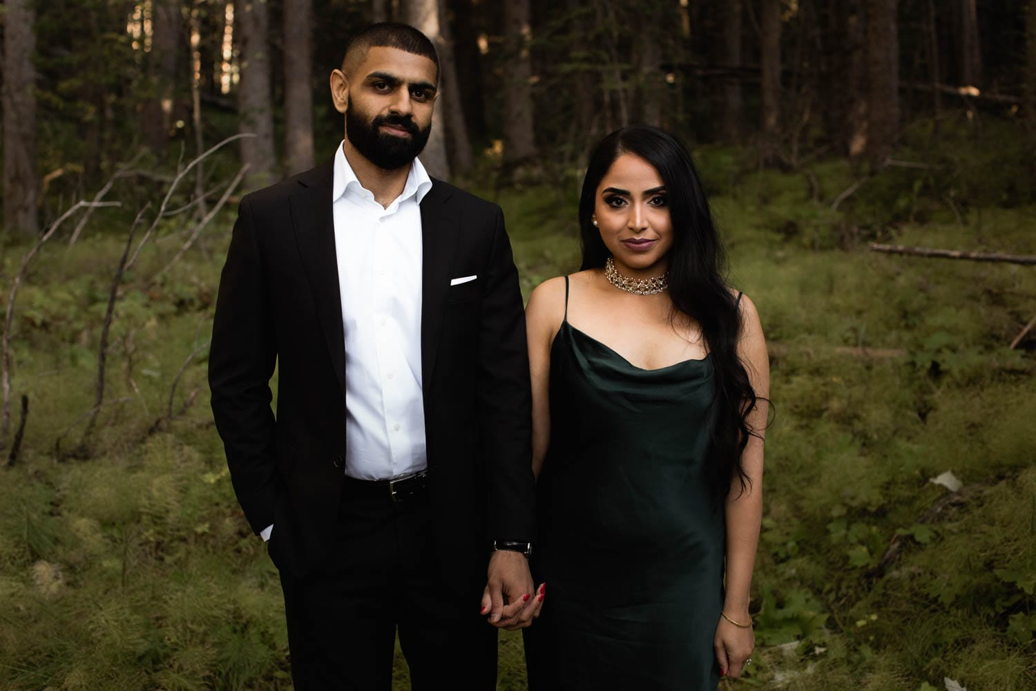 engaged couple in trees