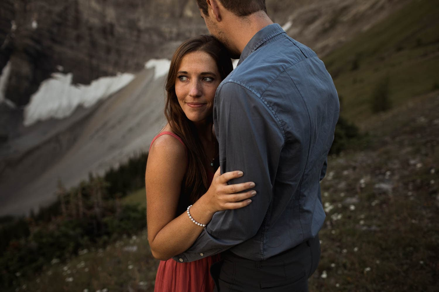 Couple at sunrise in the mountains