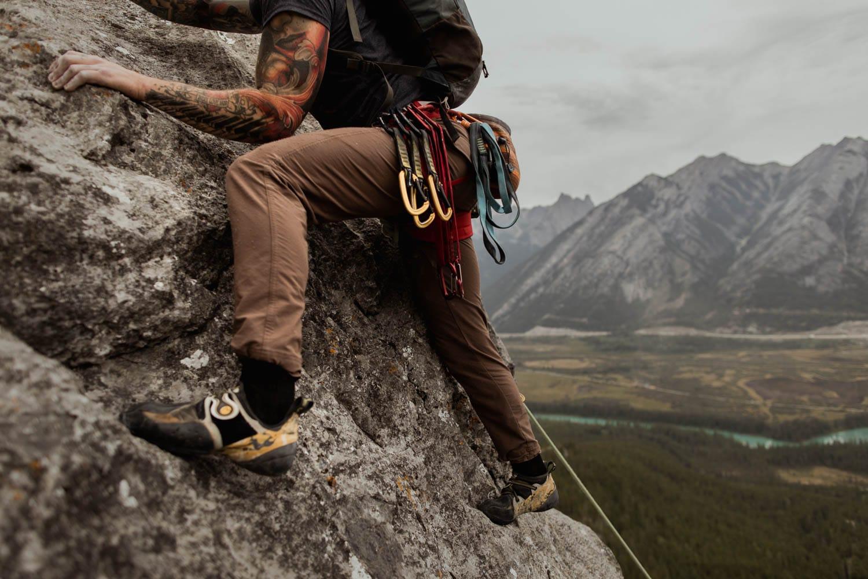Groom climbing elopement