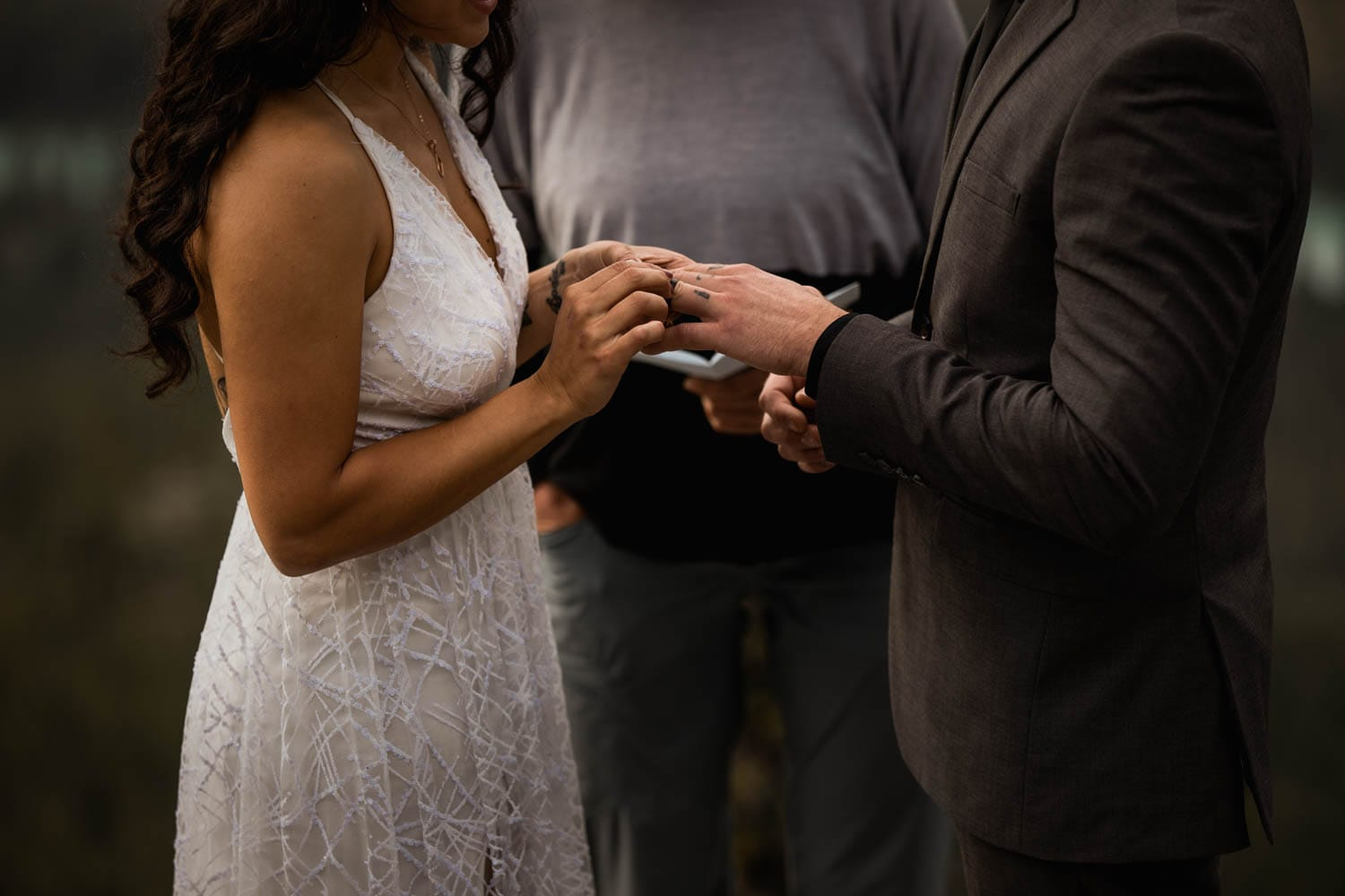 exchanging rings on top of mountain