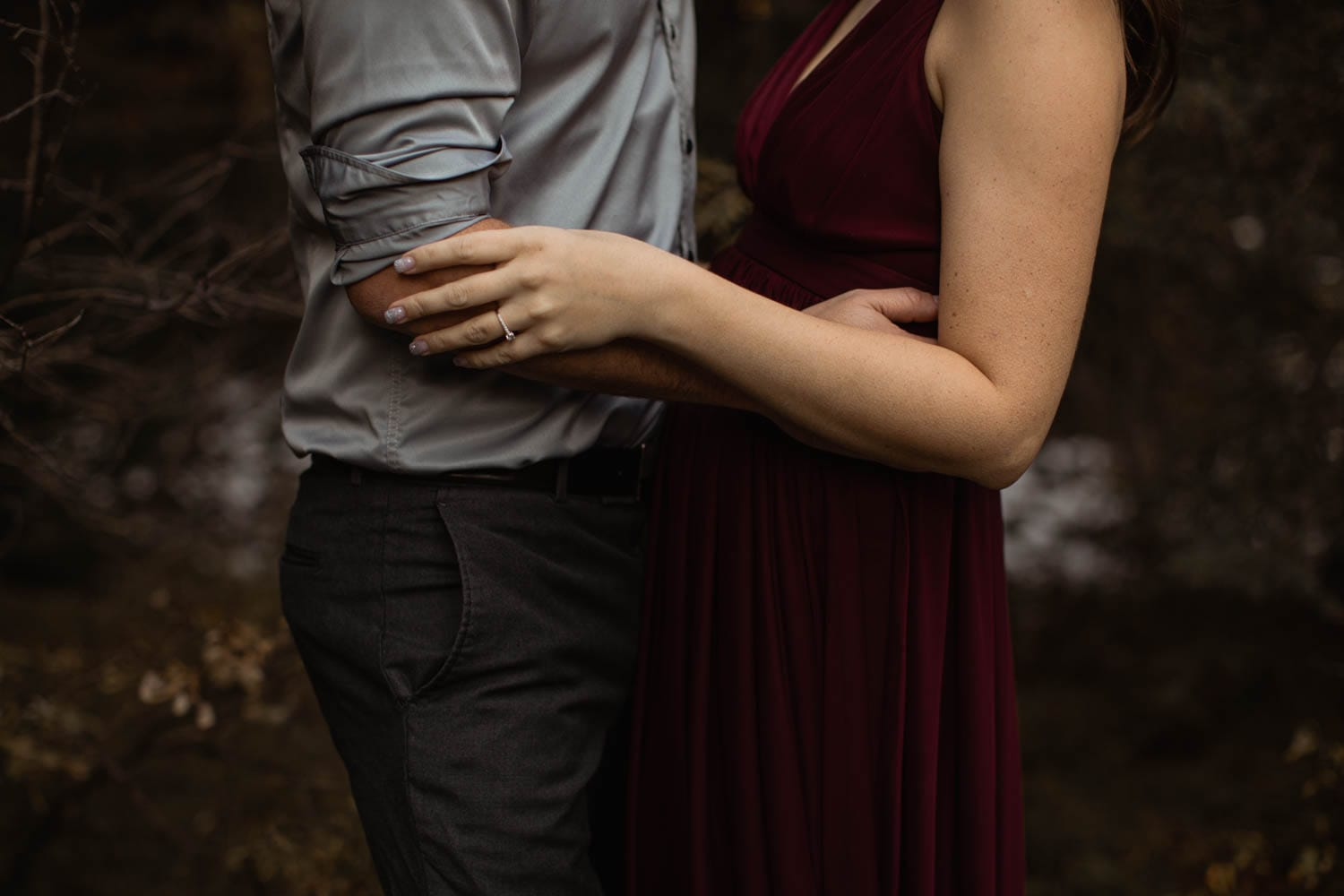Couples embrace in forest