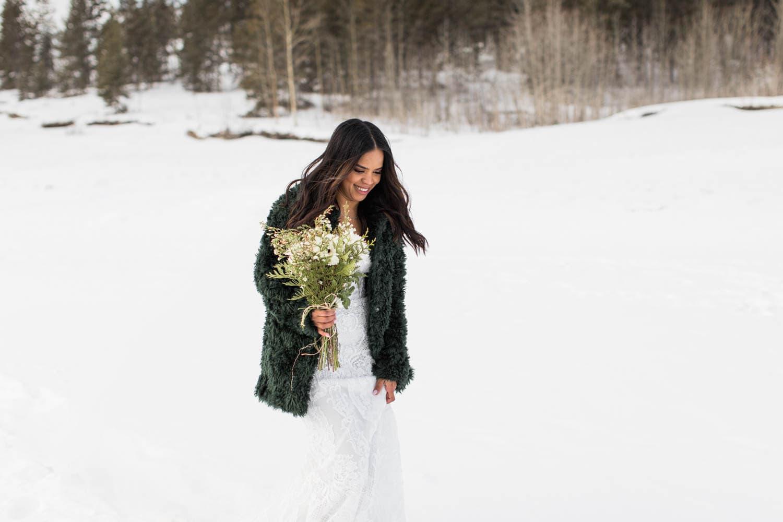 Bride walking down to Abraham Lake