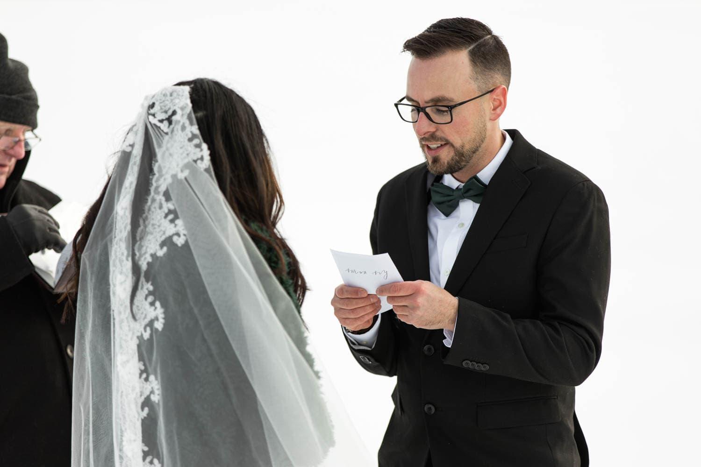 groom at winter ceremony