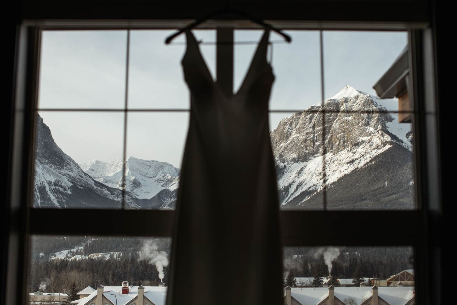 brides dress in front of mountains